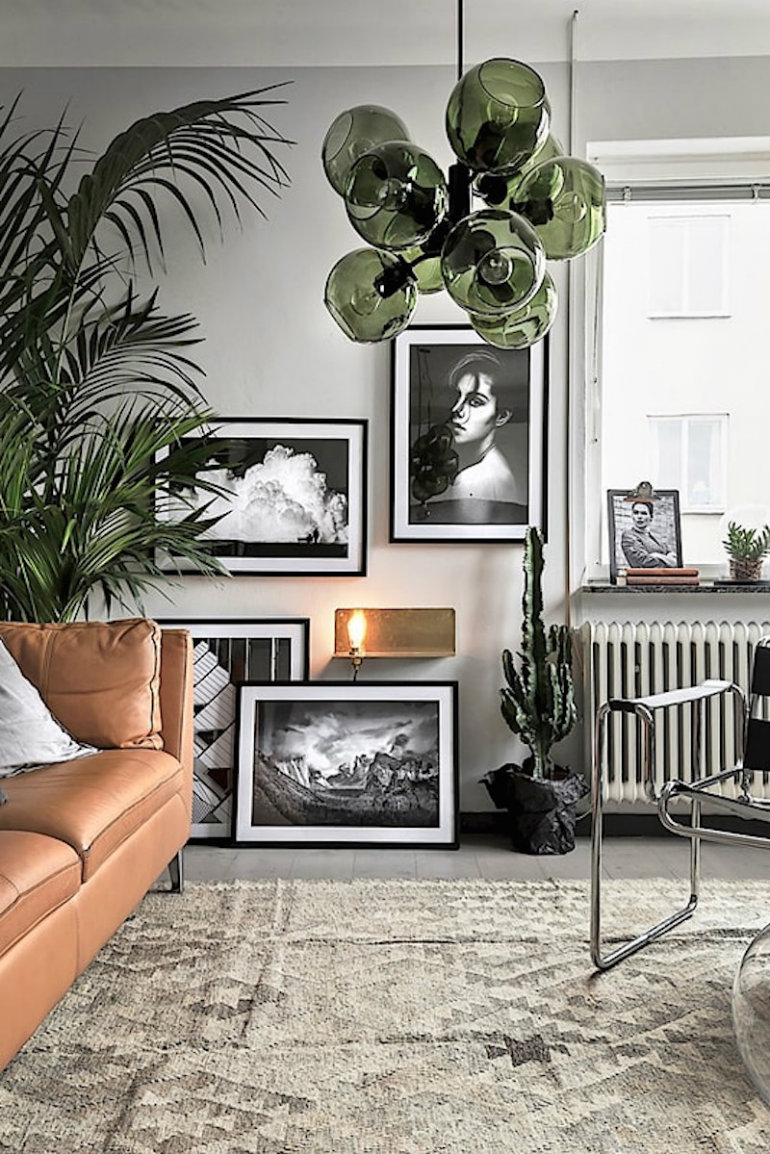 10 happy living room ideas with plants Masculine scandinavian interior. Green bubble lamp, black and white gallery wall, ethnic rug and camel leather couch with metallic elements living room ideas 10 happy living room ideas with plants 10 happy living room ideas with plants Masculine scandinavian interior