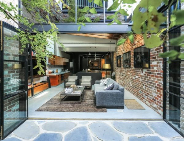 A Garage Was Converted Into This Industrial Living Room